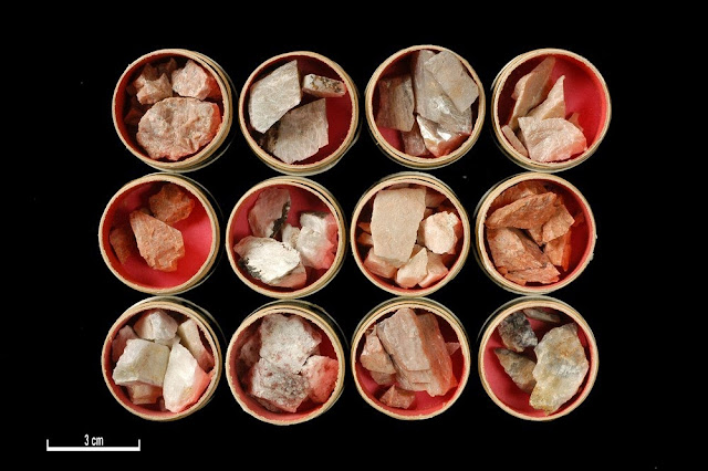 Crushed samples of feldspar from Scotland   Potash feldspar was first in demand for the production of fertilizers, later during the Second World War deposits of potash feldspar were investigated for the production of ceramic ware. British Geological Survey Petrology Collection sample number MC 7436. To extract the potash numerous methods have been devised. They include 1. Simple wet grinding and electrolysis, this proved unsuccessful and only one-third of the alkali present could be extracted by this method. 2. Treatment with chemical solutions, either caustic alkalis or acids. 3. Volatization of potash-salts, this involved heating feldspar with gypsum and carbon with potassium sulphate being volatilized and then recovered. 4. A number of dry processes for the separation of potash existed e.g. separation of potash as hydroxide or carbonate; as sodium or potassium chlorides; extraction of sodium and potassium sulphate.