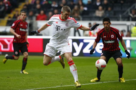 Bayern Munich player Bastian Schweinsteiger scores a goal with a backheel flick against Frankfurt