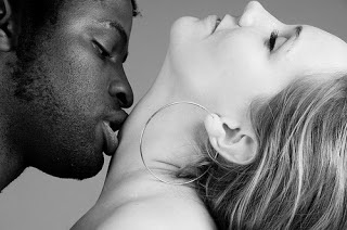 Black man and white woman kissing