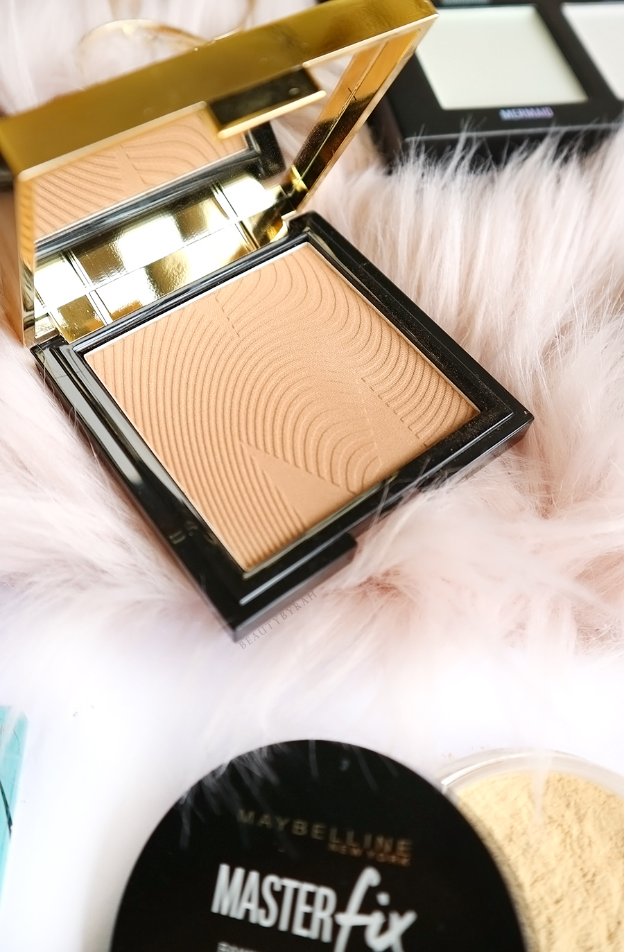 Mecca Max Sunlit Skin Bronzing Powder in Medium Review