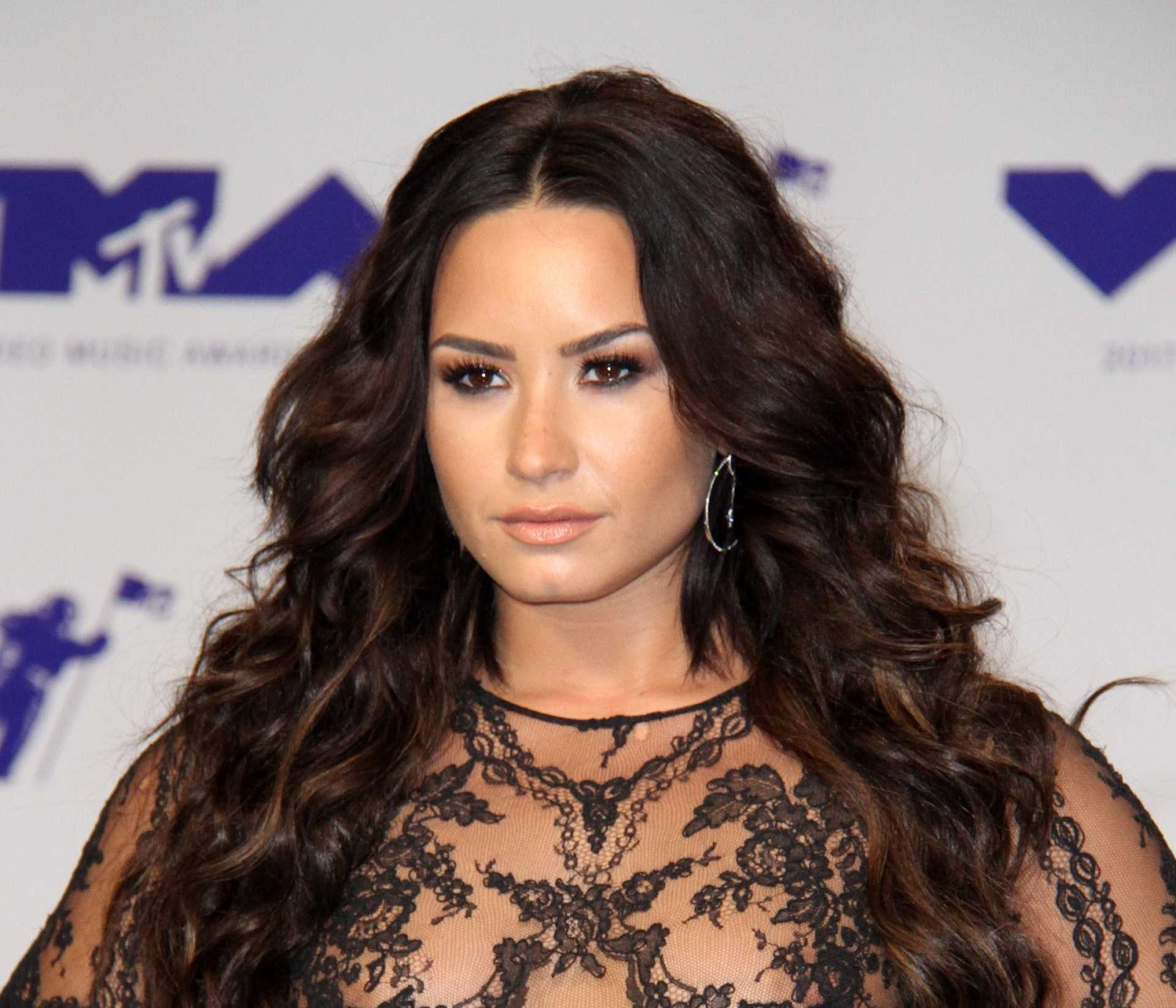 Demi Lovato flashes her nipples in lacy see-through top