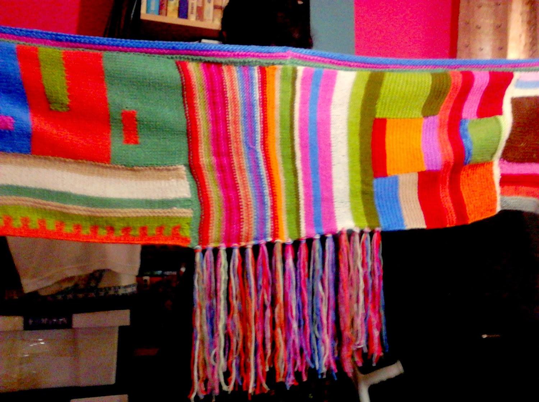 https://www.etsy.com/listing/54246073/hand-knit-shawl-scarf-wrap-joyful-colors