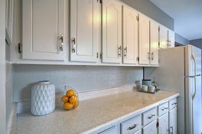 white kitchen backsplash painted tile with white cabinets