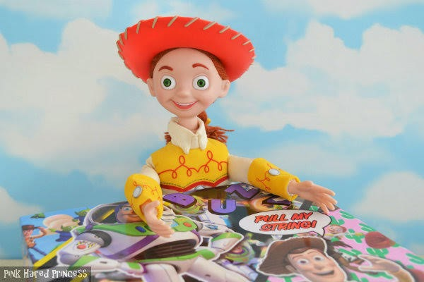 Jessie cowgirl doll head and shoulders with arms on top of Toy Story shoe box