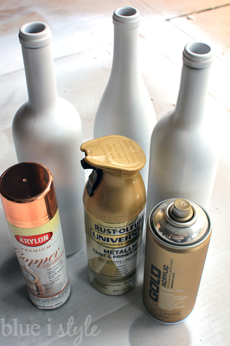 ... each bottle in a different metallic color - one silver, one gold, and  one copper. I used three different kinds of metallic spray paint {because  that's ...