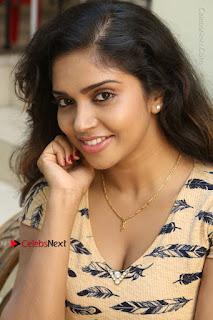 Telugu Actress Karunya Chowdary Stills in Short Dress at ATM Not Working Press Meet  0110.jpg