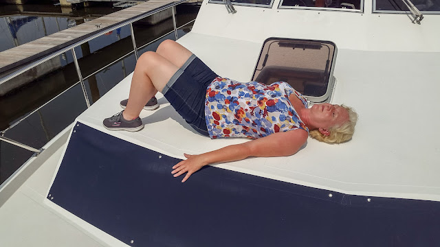 Photo of me soaking up the sun on Ravensdale's fore deck