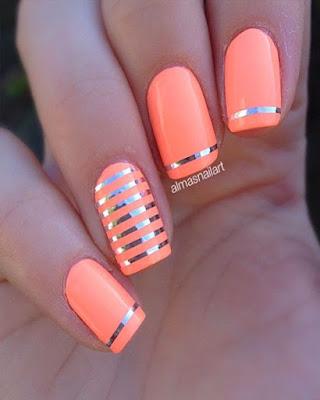 diseño de uñas a rayas naranja
