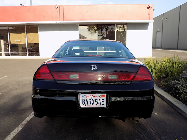 Honda Accord Coupe with faded paint after repainting at Almost Everything Auto Body.
