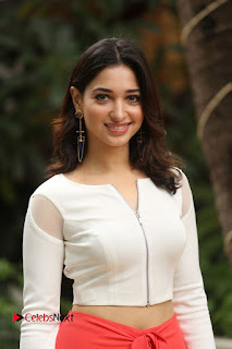 Tamannaah Bhatia Sizzling Pics in a White Crop Top and Red Parallel At Abhinetri Movie Interview