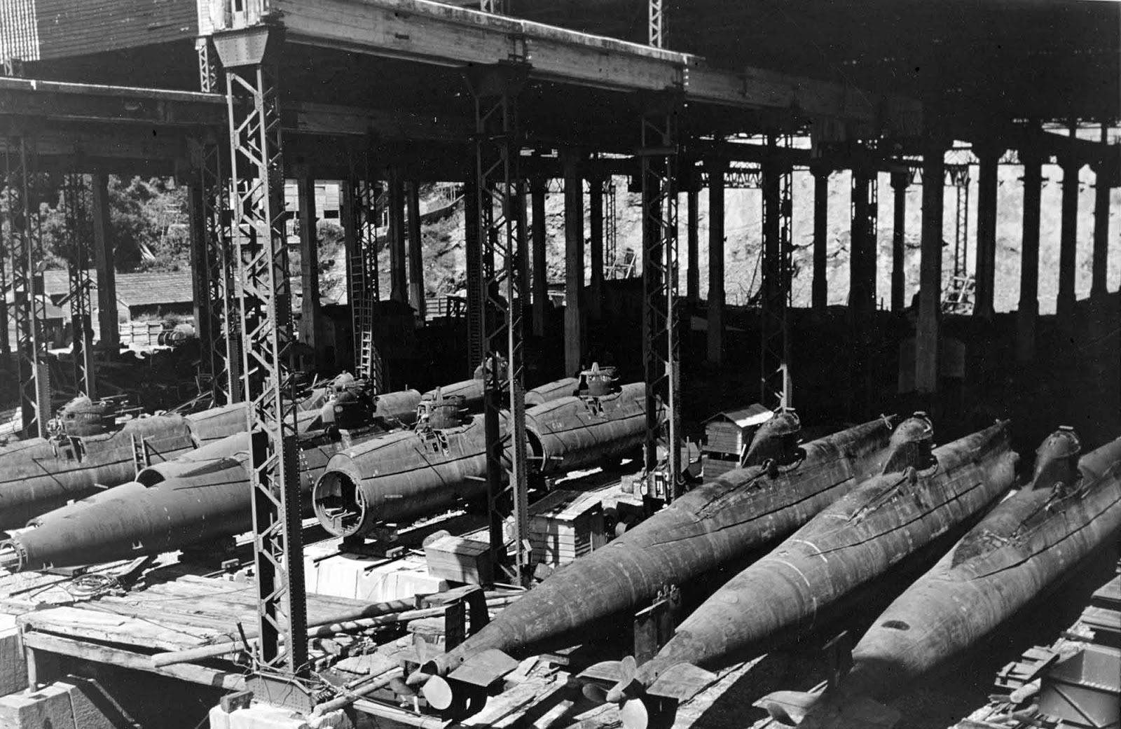 In an assembly shed at the Mitsubishi shipyard, Nagasaki. This shop contained approximately fifteen nearly complete boats, and assemblies for many more.