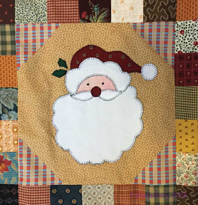 Christmas appliqued quilt by Pat