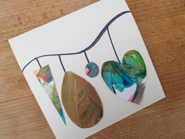 Handmade card with bauble shapes glued to it
