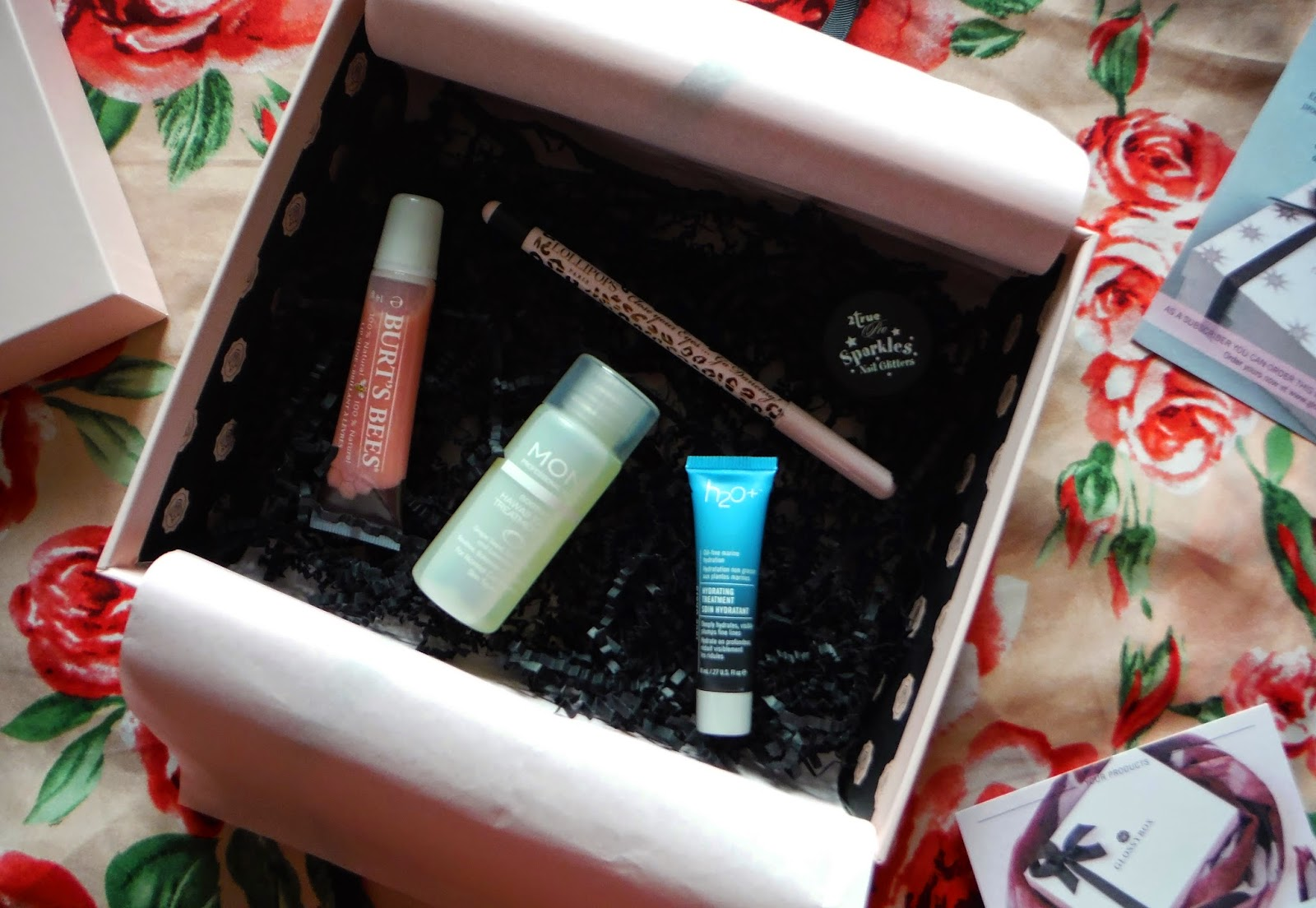 inside the November Glossybox with the beauty products on show