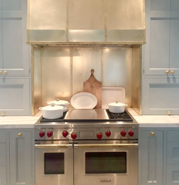 Brass range hood over Wolf range in kitchen in 2017 Southeastern Designer Showhouse in Atlanta