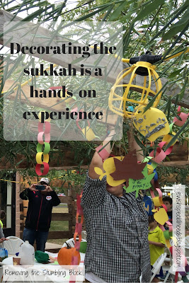 Decorating the sukkah is a hands-on experience; Removing the Stumbling Block