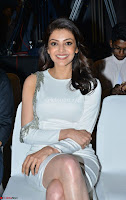 Beautiful Smiling Kajal Aggarwal in Creamy White Gown at MLA Telugu Movie Success Meet ~ .com Exclusive Pics 003.jpg