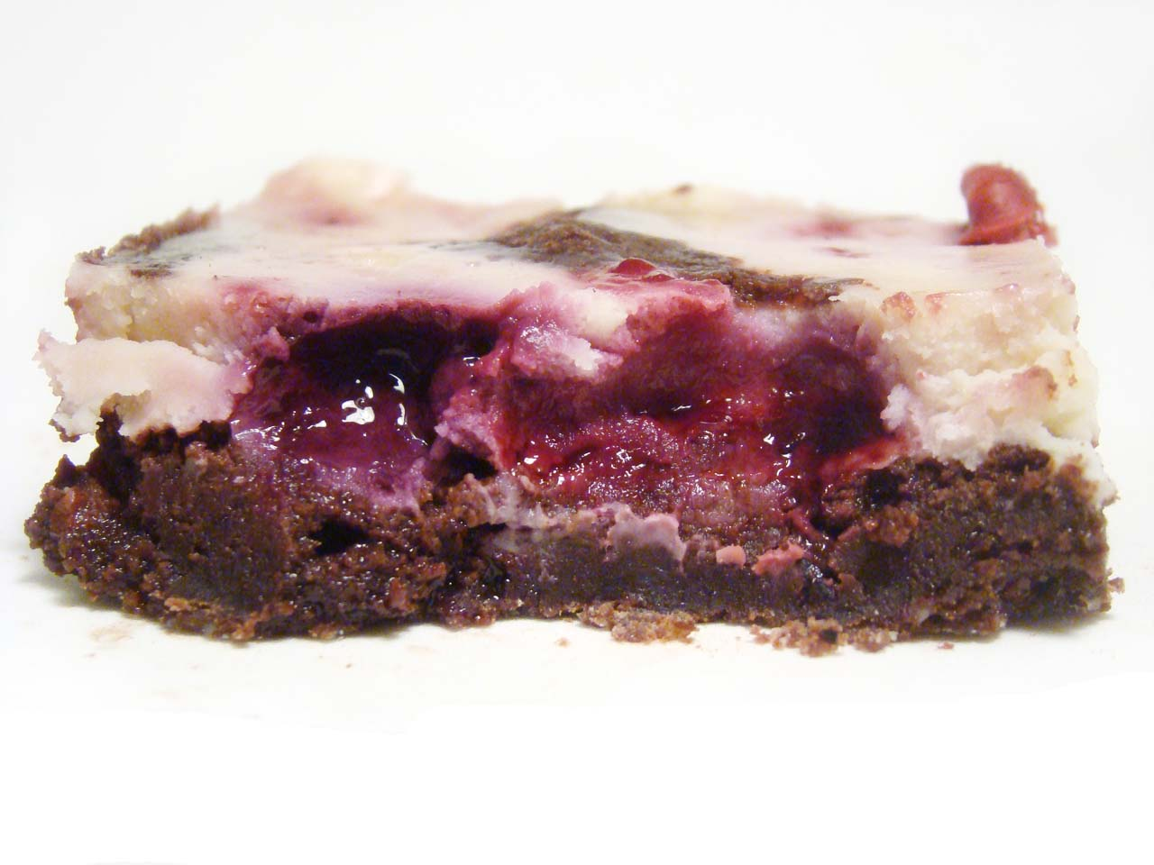 Brownie marmolado cheesecake con frutos rojos