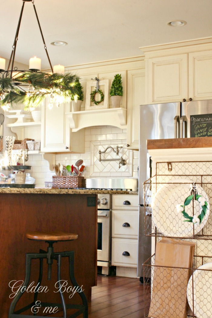 DIY mantel hood in white kitchen with preserved boxwood topiaries - www.goldenboysandme.com