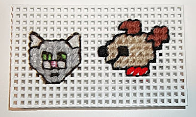 catand terrier on plastic canvas