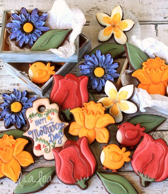 Decorated spring sugar cookies - daffodils, daisies, tulips, and plumeria