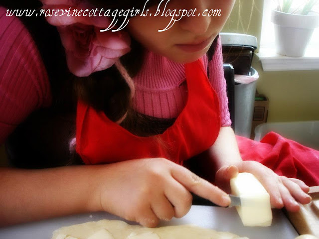girl slicing butter for apple turnover dough | rosevinecottagegirls.com