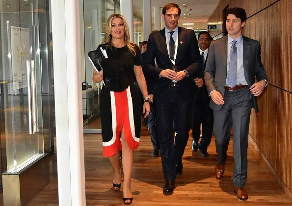 On the first day of the G20 Summit, Queen Maxima wore a colour-block wool midi dress by Michael Kors. Juliana Awada