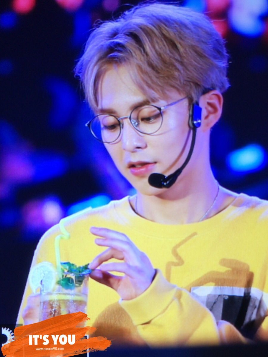 exo xiumin looks so young and cute in his yellow shirts