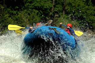 White Water Raft launching into the sky