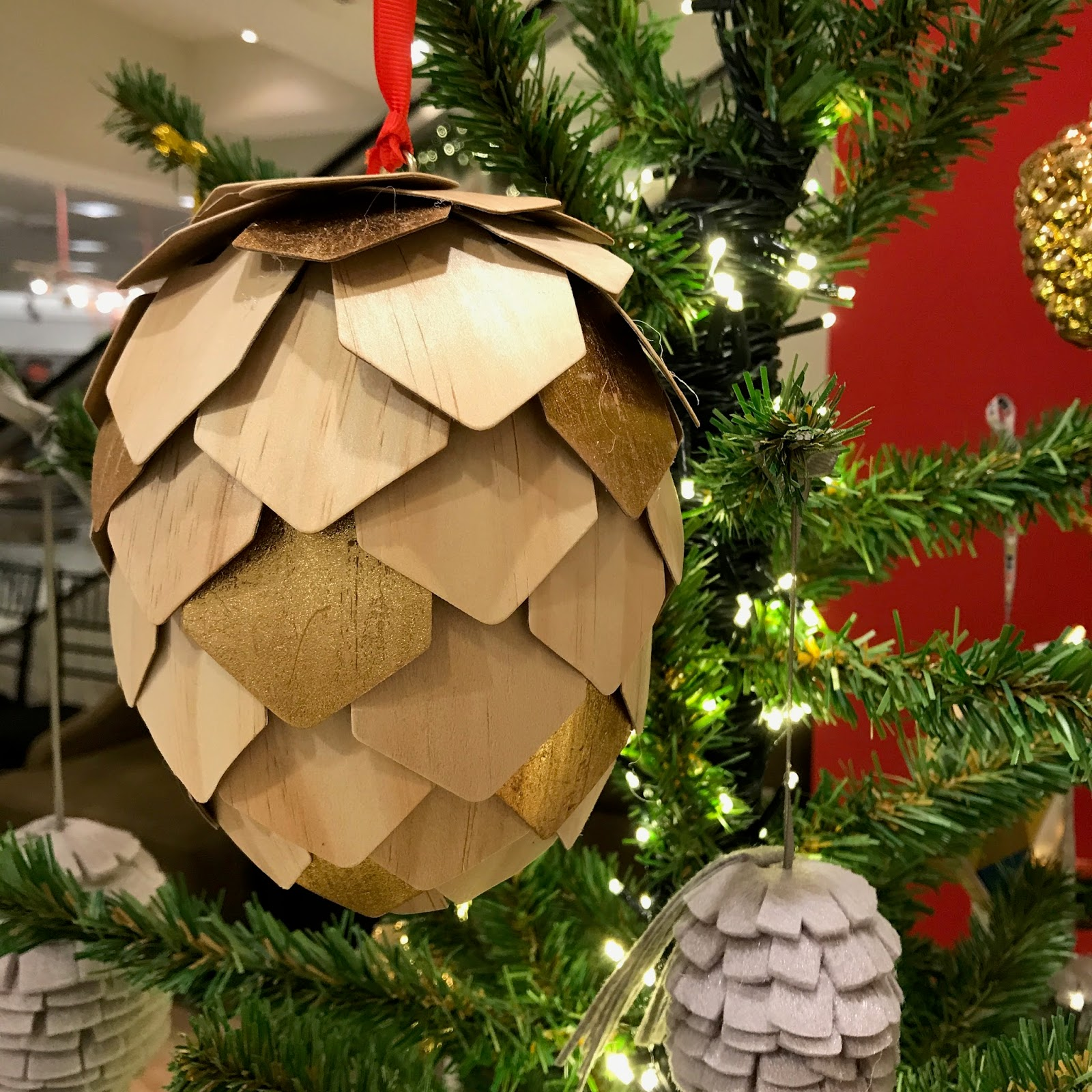Nordstrom Had Some Interesting Wooden And Felt Pine Cones.