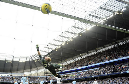 Manchester City goalkeeper Joe Hart fails to stop a goal from Gareth Bale