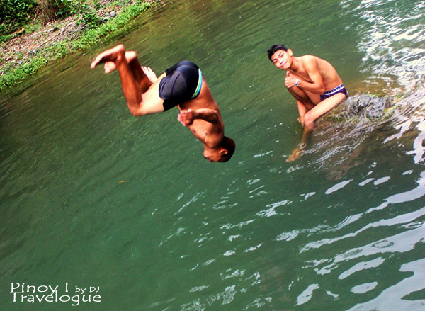 My cousin back dives into the river