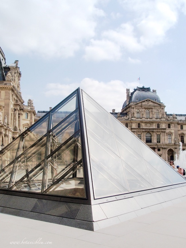 Classic French Renaissance Louvre and modern glass pyramid in Louvre courtyard