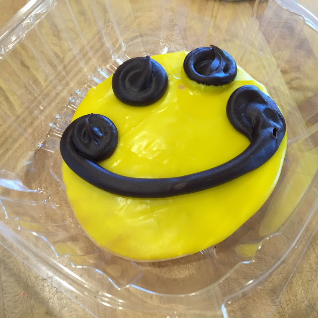 Fresh baked happy face cookie at Three Tarts Bakery in Northfield, IL