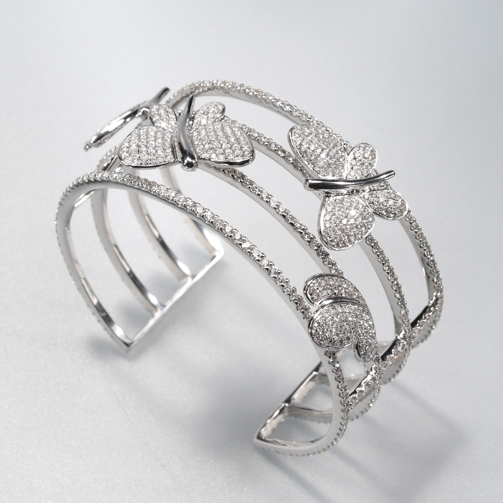 4c6a79488 An 18k white gold and diamond bangle from Winstar Jewelery Manufacturer  Ltd., Hong Kong.