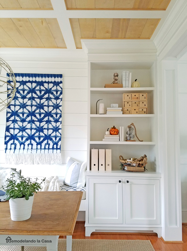 build in with inset cabinet doors in office with shibori tapestry wall art.