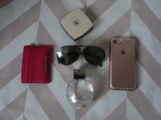 flat lay chanel compact with porche sunglasses