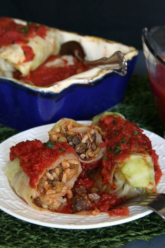 Vegan Cabbage Rolls Recipe is a special comfort food.  Steamed cabbage becomes the perfect holder for a flavorful mushroom, lentils and rice mix.  It can be made ahead too. #maindish #vegan #veganfood #dinner #veganrecipes #plantbased #glutenfree #veganinthefreezer