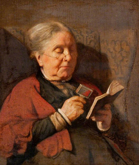 Painting of old woman reading a book by Rembrandt.