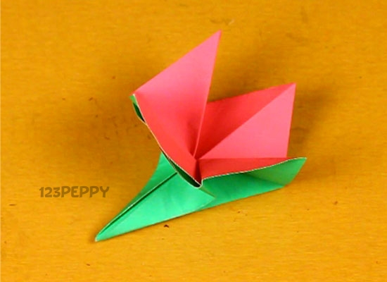 Spring time flower art simple origami flowers this video gives you step by step directions on how to make this cute little bud mightylinksfo