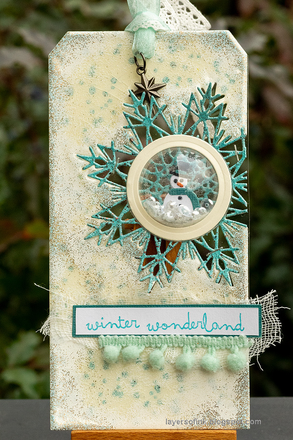 Layers of ink - Embossed Snowflake Tag Tutorial by Anna-Karin Evaldsson.