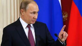Vladimir Putin signs domestic violence law in Russia