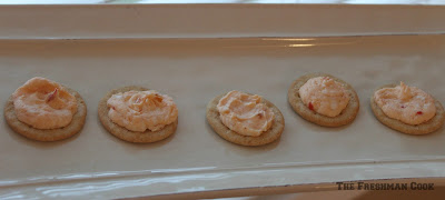 cream cheese, sweet chilli sauce, milk, crackers, piping bag