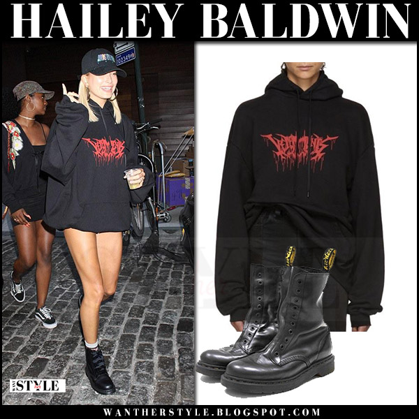Hailey Baldwin in black hoodie and black leather ankle boots dr martens vetements what she wore july 29 2017 model style