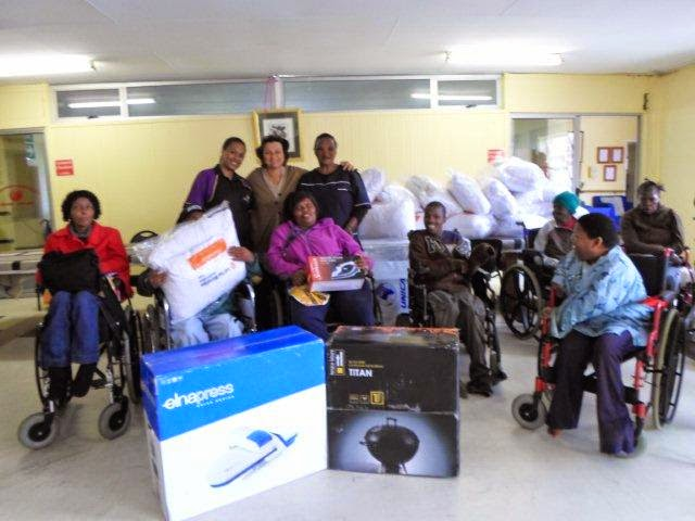 The Hollywoodbets Sgt Peppers (PE) team with donations made to the Cleary Estate Cheshire Home - Port Elizabeth
