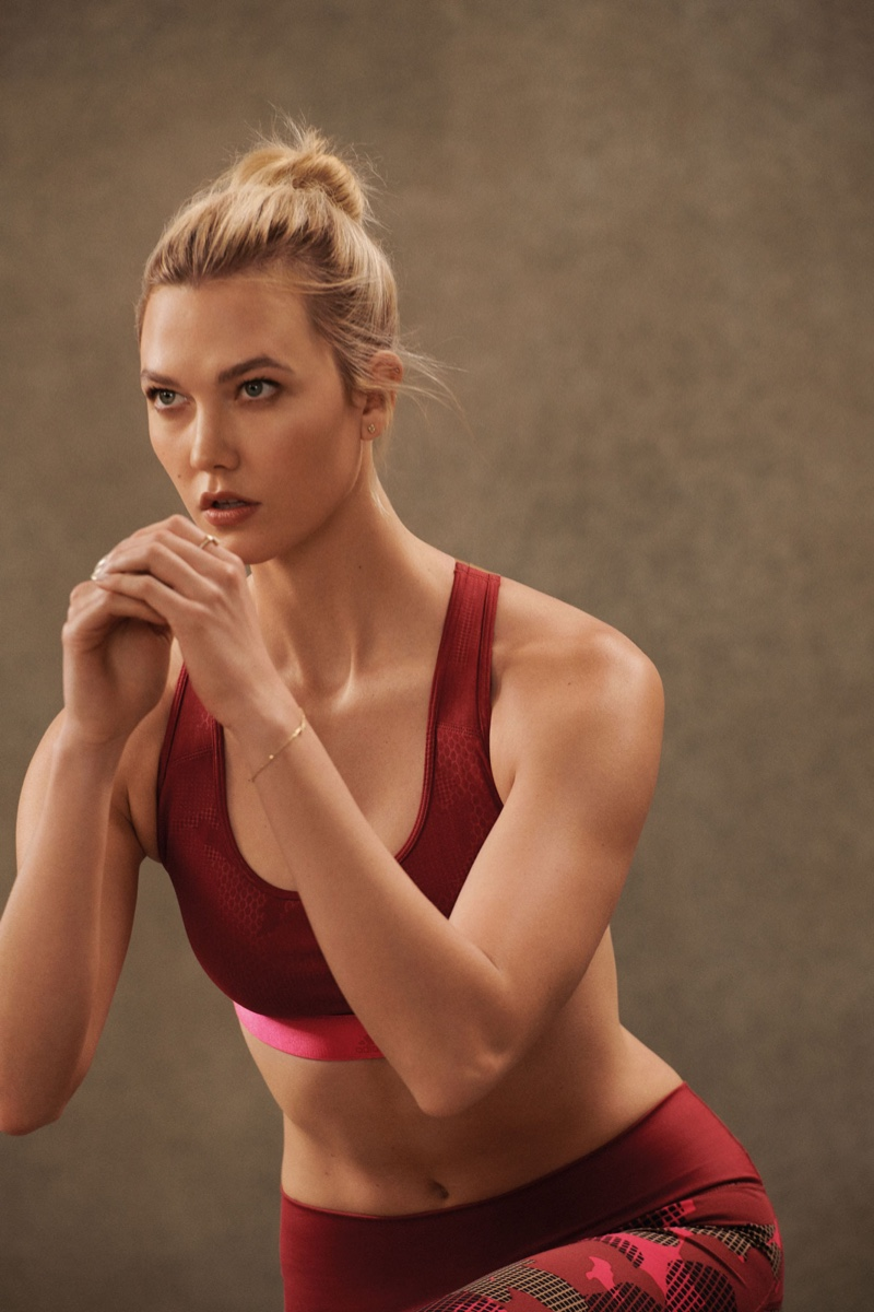 Showing off her lithe figure, Karlie Kloss poses in adidas designs