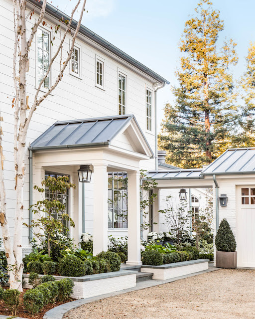 Beautiful modern farmhouse style home exterior with metal roof and white siding, Giannetti Home