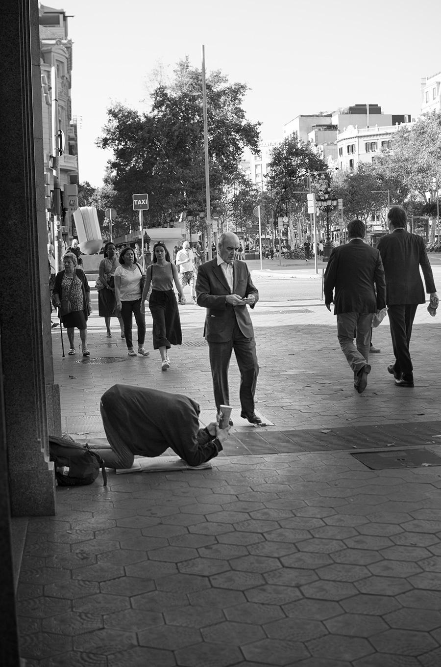 Man Begging at Passeig de Gracia Barcelona
