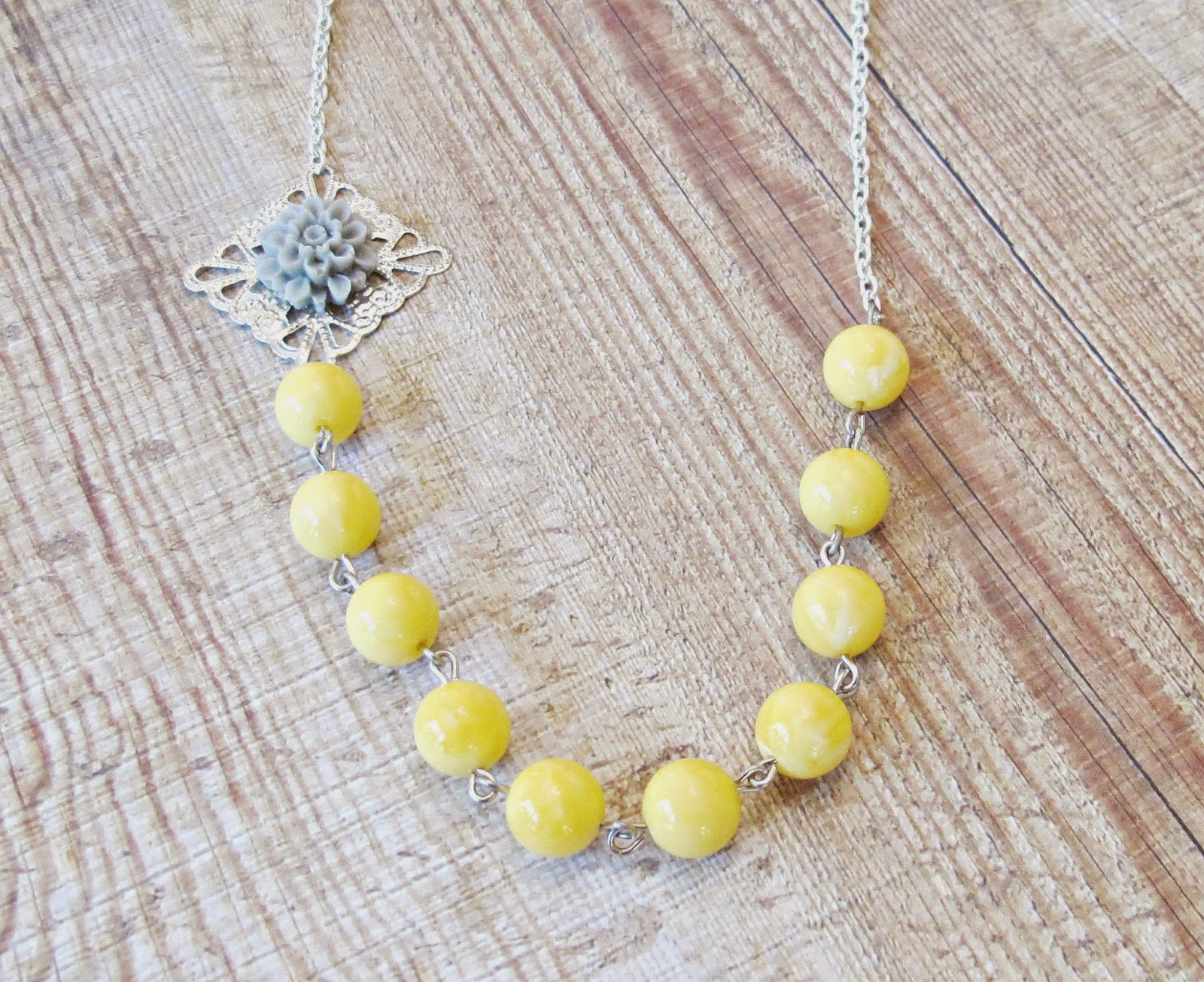 image quendi necklace two cheeky monkeys asymmetrical yellow grey gray silver jewellery