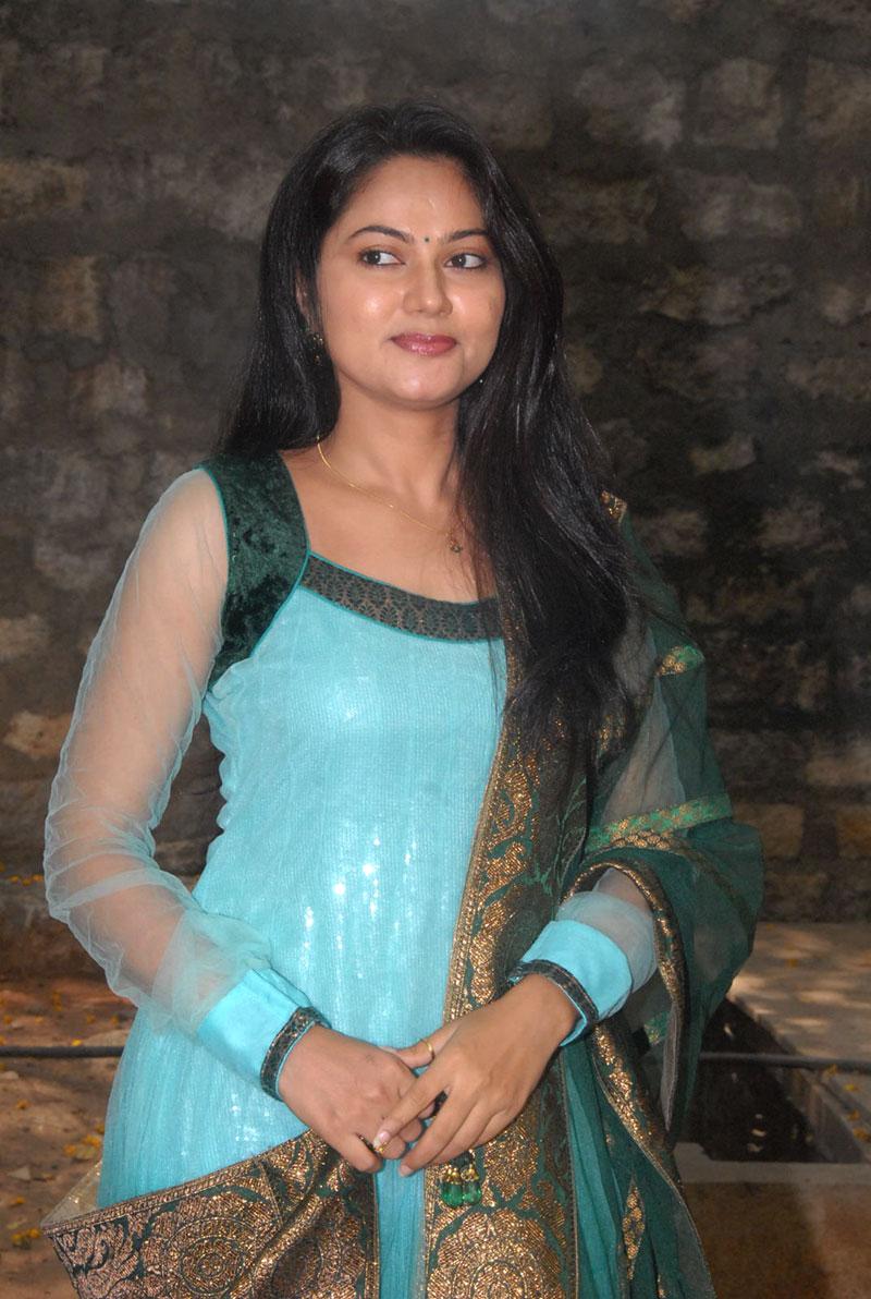 Tv Actress Suhasini Long Hair Stills In Green Dress
